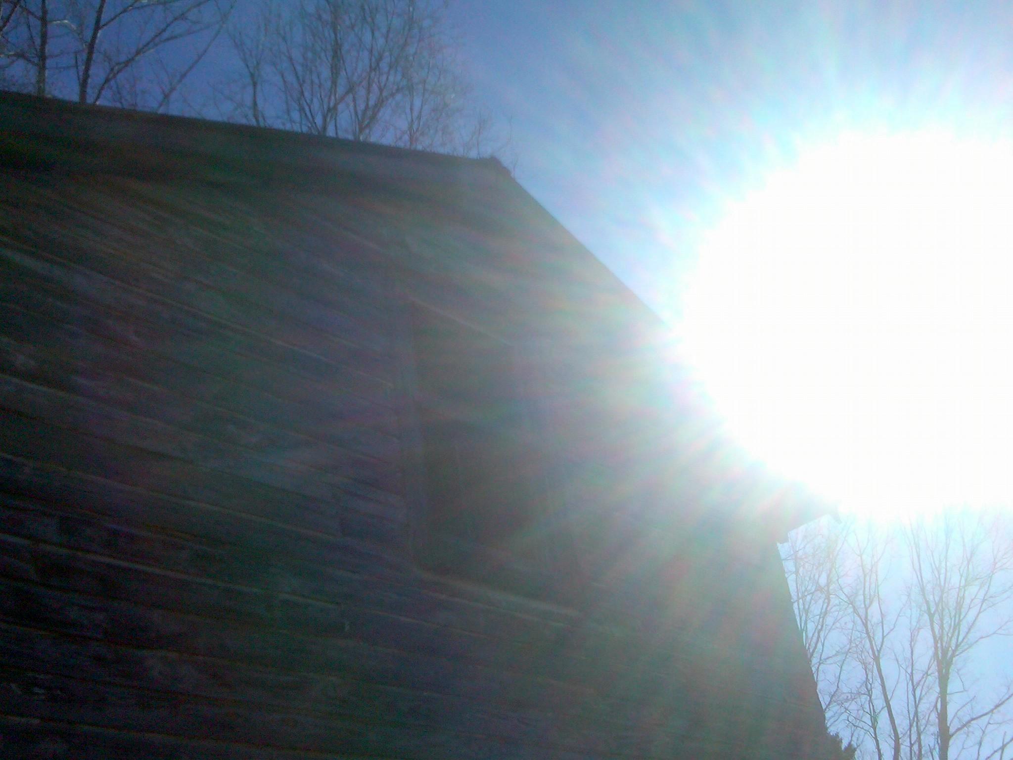 Sun over barn